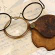Pair of spectacles and magnifying glass — Stock fotografie #11842354