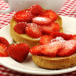 Two rusks with sugared strawberries — Stock Photo