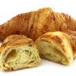 Freshly baked croissant and two halves — Zdjęcie stockowe