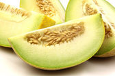 Fresh galia melon pieces — Stock Photo