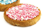 Rusks with white and blue and white and pink anise seed sprinkles — Stock Photo