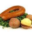 Freshly cut kale cabbage and a smoked sausage — Stock Photo