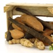 Bunch of mixed vegetables coming out of a wooden box — Stock Photo