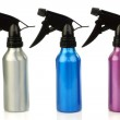 Three colorful metal spray bottles — Stock Photo #11911701