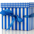 Blue and white gift box with a blue ribbon — Stok fotoğraf