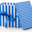 Opened blue and white gift box with a blue ribbon — Foto de Stock