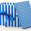 Opened blue and white gift box with a blue ribbon — Photo