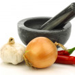 Mortar and pestle and some fresh vegetables — Stock Photo