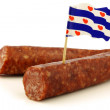 Traditional frisian dried sausage pieces with a frisian flag toothpick — Stock Photo