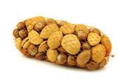 Míchané ořechy v oranžový plast — Stock fotografie