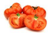 Carne en rodajas de tomate y los dos enteros — Foto de Stock