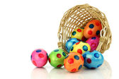 Colorful easter eggs coming from a wicker basket — Stock Photo