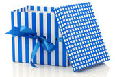 Opened blue and white gift box with a blue ribbon — Stock Photo