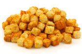 Bunch of tomato and paprika croutons — Stock Photo