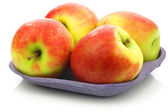 "Fresh new apple cultivar called ""Pink Lady"" on a tray — Stock Photo"