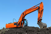 Excavator on a compost heap — Stock Photo