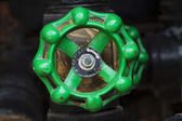 Green rusty industrial faucet wheel — Stok fotoğraf