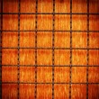 Rusty metal grid on wood background - Stock Photo