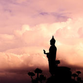 Buddha silhouette on sunset sky. — Photo