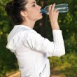 Portrait of young fitness woman with a bottle of water — 图库照片
