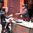 Stock Photo: Chinese Street Food Purchase