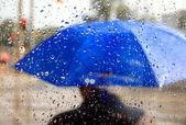 Man With Blue Umbrella — Stock Photo