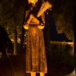 Monument of a girl to the Holodomor victims in night — Stock Photo