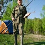 Fisherman caught a fish carp — Stock Photo