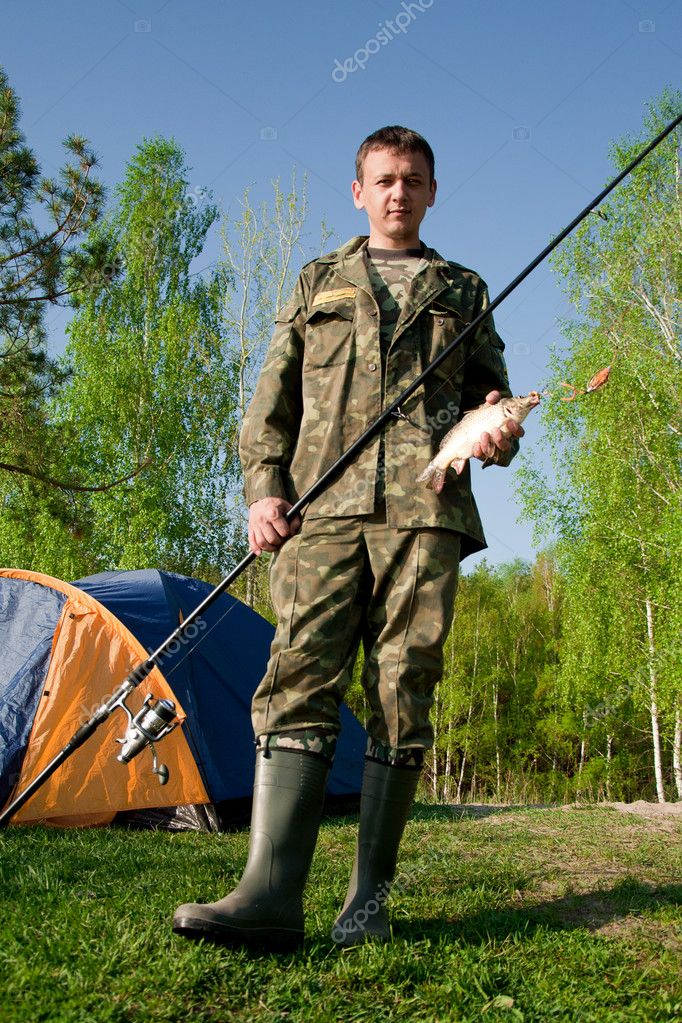 Fisherman caught a fish carp — Stock Photo #11528952