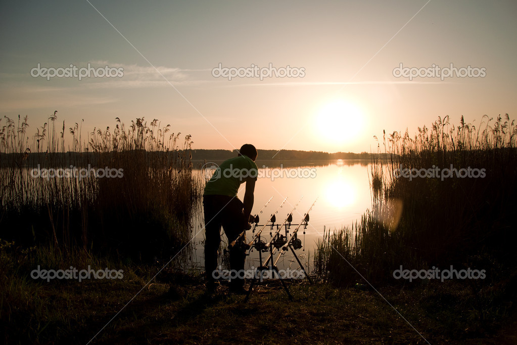 The fisherman fishes on a sunset — Stock Photo #11528978