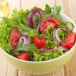 Fresh salad with cucumbers tomatoes and onions — Stock Photo