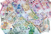 Currencies, worldwide money, banknotes, exchange rate — Stock Photo