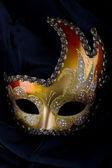 Rojo, oro y máscara veneciano — Foto de Stock