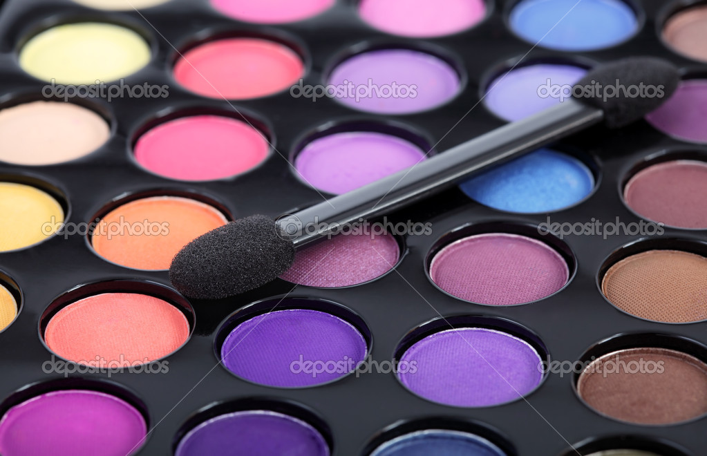 Make-up brush on colorful eye shadows palette — Stock Photo #11127818