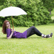 Young womwith umbrelllying in park — Stock Photo #11385338