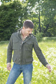 Man standing in a meadow — Stock Photo