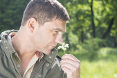 Man picking a flower — Stock Photo