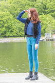 Young woman standing on a jetty — Stock Photo