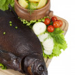 Stock Photo: Smoked bream on wooden board with hot potato in clay pot,