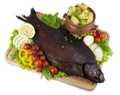 Smoked bream on a wooden board with a hot potato in a clay pot, — Stock Photo