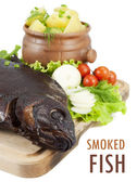 Smoked bream closeup on a wooden board with a hot potato in a cl — Stock Photo
