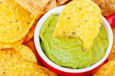 Chip in Guacamole Macro — Stock Photo