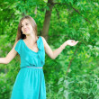Young woman wondering near a copyspace outdoors - Stock Photo