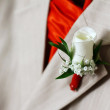 Wedding boutonniere on a suit - Stock Photo