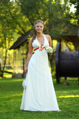 Young beautiful bride outdoors - Full length portrait — Stock Photo