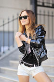 Young lady in sunglasses — Stock Photo