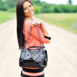 Beautiful girl with bag — Stock Photo