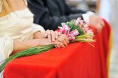 Bride holding wedding bouquet during wedding ceremony — Stock Photo