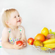Adorable little girl with apple — Stock Photo
