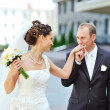 Groom kissing bride's hand while walking together — Stock Photo